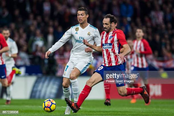 Cristiano Ronaldo of Real Madrid competes for the ball with Juan Francisco Torres Belen Juanfran of Atletico de Madrid during the La Liga 201718...
