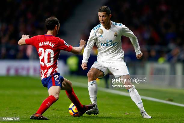Cristiano Ronaldo of Real Madrid competes for the ball with Juanfran Torres of Atletico Madrid during the La Liga match between Atletico Madrid and...
