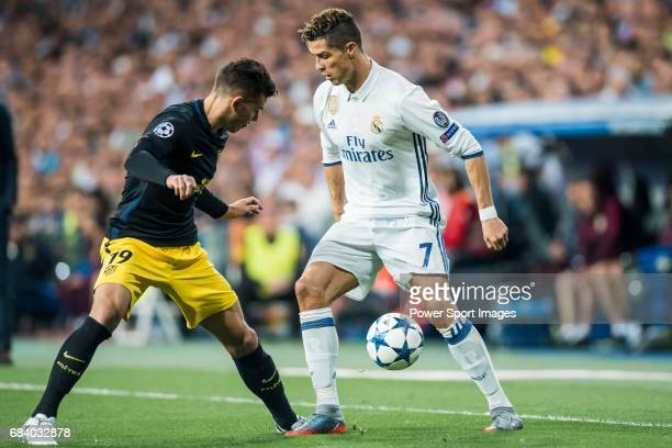 Cristiano Ronaldo of Real Madrid competes for the ball with Lucas Hernandez of Atletico de Madrid during their 201617 UEFA Champions League...