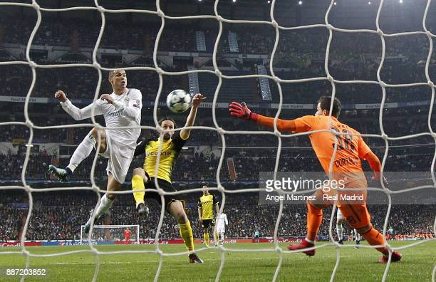 Cristiano Ronaldo of Real Madrid competes for the ball with Neven Subotic of Borussia Dortmund during the UEFA Champions League group H match between...