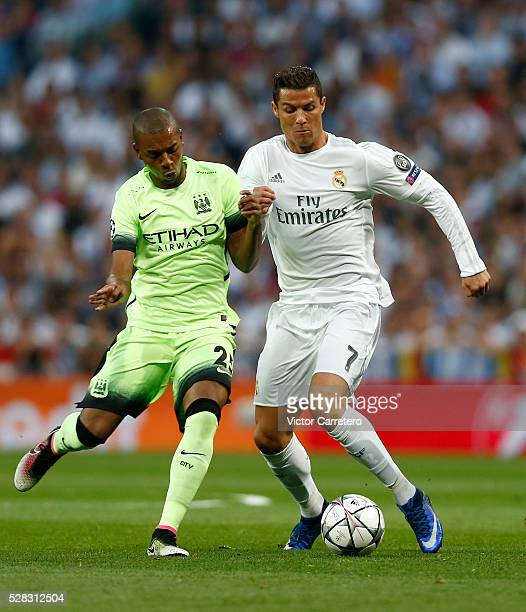 Cristiano Ronaldo of Real Madrid competes for the ball with Fernandinho of Manchester City during the UEFA Champions League Semi Final second leg...