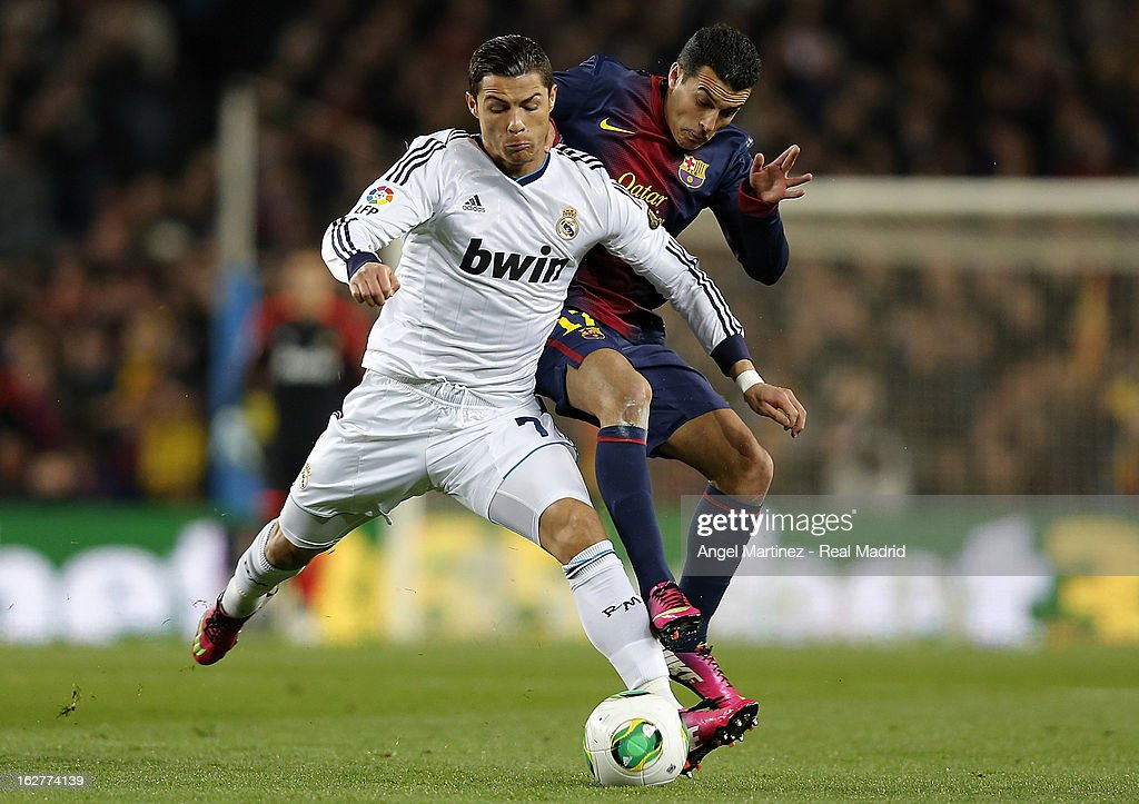 Cristiano Ronaldo of Real Madrid competes for the ball with Pedro Rodriguez of Barcelona during the Copa del Rey semi final second leg match between FC Barcelona and Real Madrid CF at Camp Nou on February 26, 2013 in Barcelona, Spain.