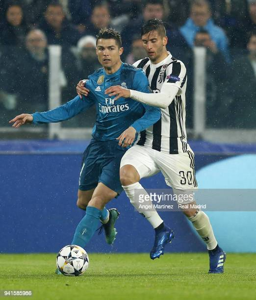 Cristiano Ronaldo of Real Madrid competes for the ball with Rodrigo Bentancur of Juventus during the UEFA Champions League Quarter Final Leg One...