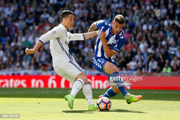 Cristiano Ronaldo of Real Madrid competes for the ball with Theo Hernandez of Alaves during the La Liga match between Real Madrid and Deportivo...