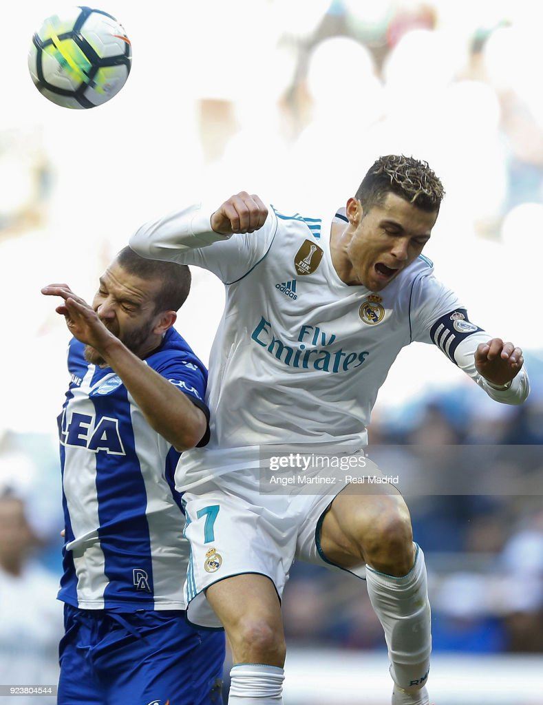 Cristiano Ronaldo of Real Madrid competes for the ball with Victor Laguardia of Deportivo Alaves during the La Liga match between Real Madrid and Deportivo Alaves at Estadio Santiago Bernabeu on February 24, 2018 in Madrid, Spain.