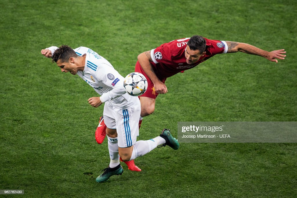 Cristiano Ronaldo of Real Madrid competes with James Milner of Liverpool during the UEFA Champions League final between Real Madrid and Liverpool on May 26, 2018 in Kiev, Ukraine.