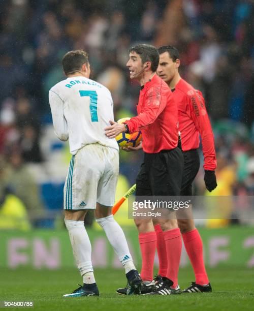 Cristiano Ronaldo of Real Madrid complains to Referee Undiano Mallenco during the La Liga match between Real Madrid and Villarreal at Estadio...