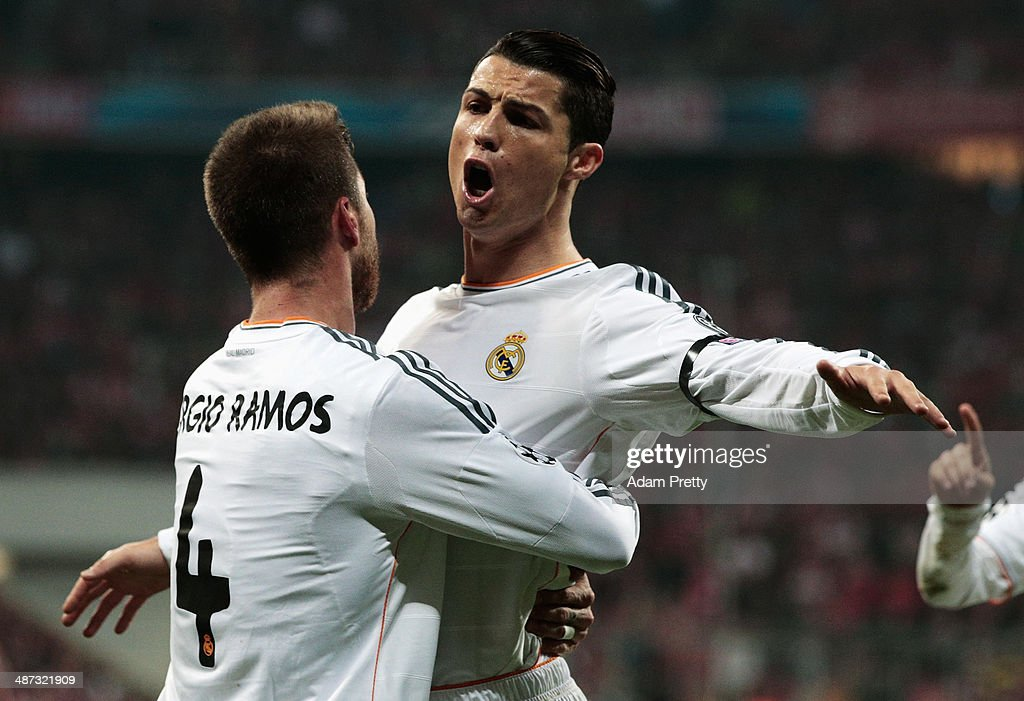 Cristiano Ronaldo of Real Madrid congratulates goalscorer Sergio Ramos of Real Madrid during the UEFA Champions League semi-final second leg match between FC Bayern Muenchen and Real Madrid at Allianz Arena on April 29, 2014 in Munich, Germany.