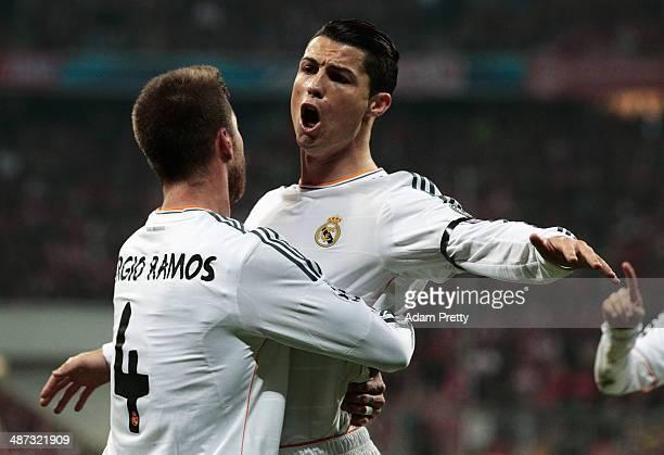 Cristiano Ronaldo of Real Madrid congratulates goalscorer Sergio Ramos of Real Madrid during the UEFA Champions League semifinal second leg match...