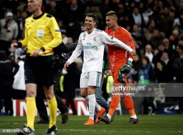 Cristiano Ronaldo of Real Madrid congratulates Paris SaintGermain's keeper Alphonse Areola after the UEFA Champions League Round of 16 football match...