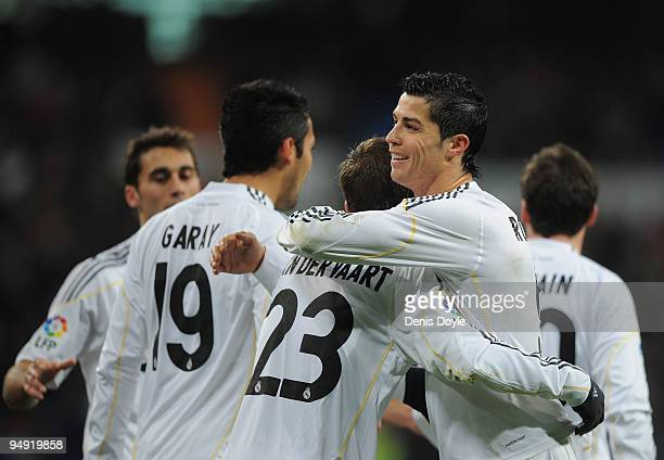 Cristiano Ronaldo of Real Madrid congratulates Rafael Van Der Vaart after he scored Real's first goal during the La Liga match between Real Madrid...