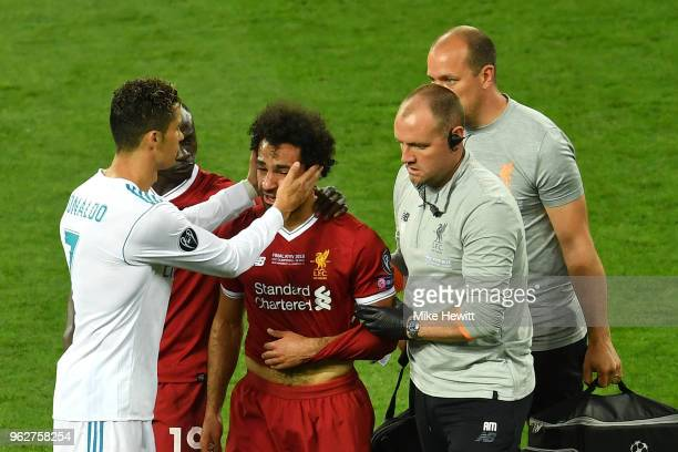 Cristiano Ronaldo of Real Madrid consoles Mohamed Salah of Liverpool as he leaves the pitch injured during the UEFA Champions League Final between...