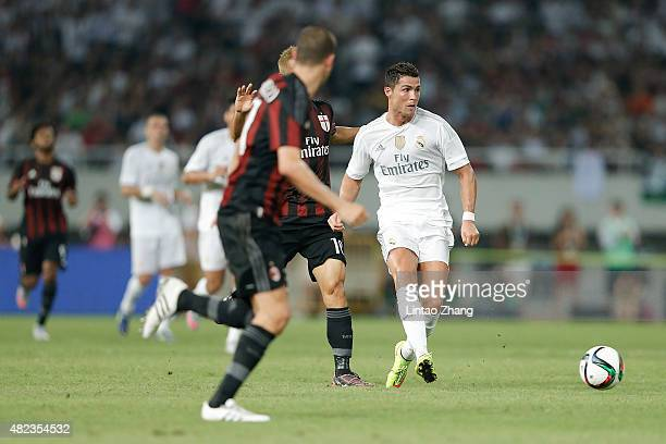Cristiano Ronaldo of Real Madrid contests the ball against Keisuke Honda of AC Milan during the International Champions Cup match between Real Madrid...