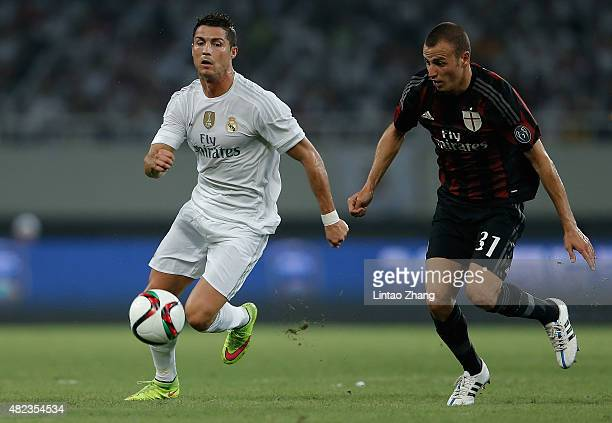 Cristiano Ronaldo of Real Madrid contests the ball against Luca Antonelli of AC Milan during the International Champions Cup match between Real...