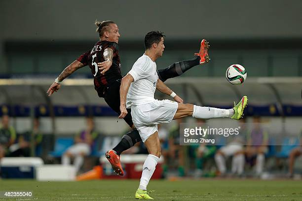 Cristiano Ronaldo of Real Madrid contests the ball against Phillppe Mexes of AC Milan during the International Champions Cup match between Real...