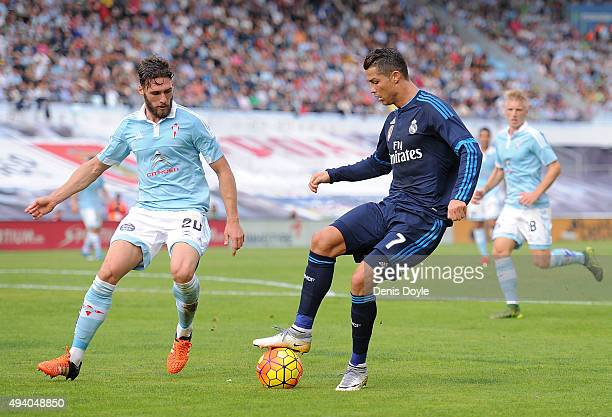 Cristiano Ronaldo of Real Madrid controls the ball beside Augusto Fernandez of Celta Vigo during the La Liga match between Celta Vigo and Real Madrid...