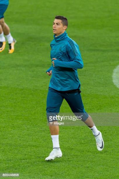 Cristiano Ronaldo of Real Madrid controls the ball during a Real Madrid training session ahead of their UEFA Champions League Group H match against...