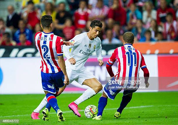 Cristiano Ronaldo of Real Madrid controls the ball during the La Liga match between Sporting Gijon and Real Madrid at Estadio El Molinon on August 23...