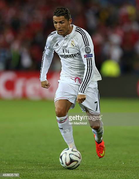 Cristiano Ronaldo of Real Madrid controls the ball during the UEFA Super Cup match between Real Madrid and Sevilla at Cardiff City Stadium on August...