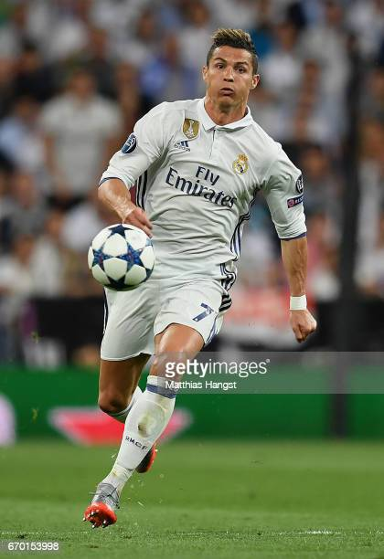Cristiano Ronaldo of Real Madrid controls the ball during the UEFA Champions League Quarter Final second leg match between Real Madrid CF and FC...