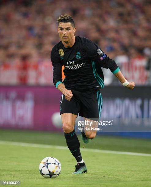 Cristiano Ronaldo of Real Madrid controls the ball during the UEFA Champions League Semi Final First Leg match between Bayern Muenchen and Real...