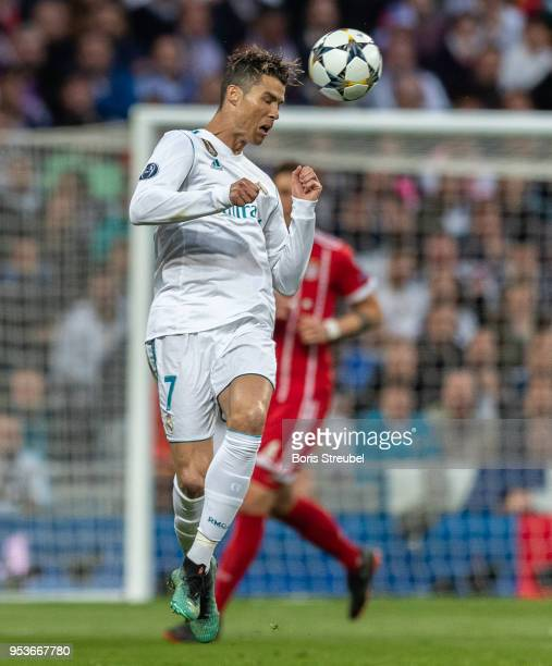 Cristiano Ronaldo of Real Madrid controls the ball during the UEFA Champions League Semi Final Second Leg match between Real Madrid and Bayern...