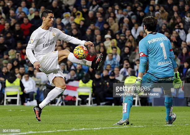 Cristiano Ronaldo of Real Madrid controls the ball in front of German Lux of Depotivo La Coruna during the La Liga match between Real Madrid CF and...