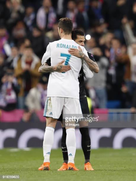 Cristiano Ronaldo of Real Madrid Dani Alves of Paris SaintGermain during the UEFA Champions League round of 16 match between Real Madrid and Paris...
