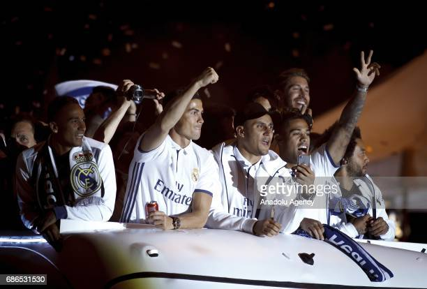 Cristiano Ronaldo of Real Madrid Danilo and Mariano during celebrations at Cibeles Fountain after winning the 2016/17 Spanish football league at...