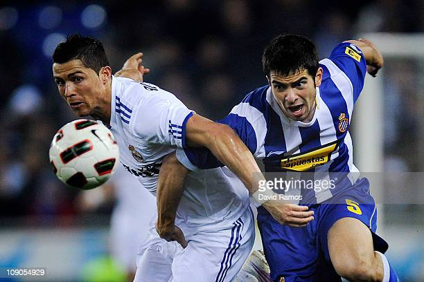 Cristiano Ronaldo of Real Madrid duels for the ball against Jordi Amat of RCD Espanyol during La Liga match between RCD Espanyol and Real Madrid at...