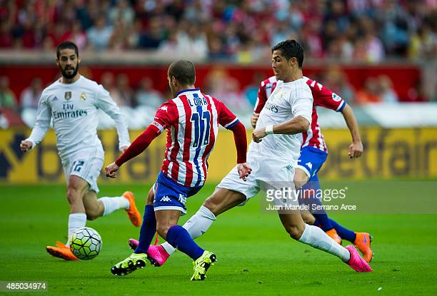 Cristiano Ronaldo of Real Madrid duels for the ball with Alberto Lora of Real Sporting de Gijon during the La Liga match between Sporting Gijon and...
