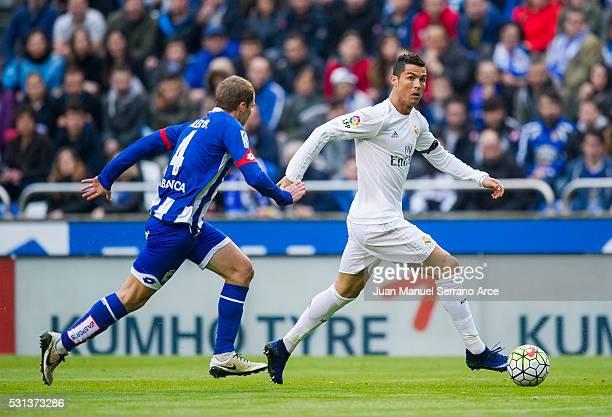 Cristiano Ronaldo of Real Madrid duels for the ball with Alex Bergantinos of RC Deportivo La Coruna during the La Liga match between RC Deportivo La...