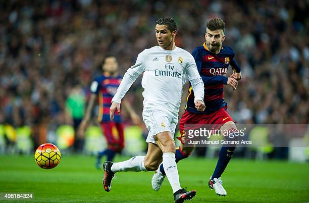 Cristiano Ronaldo of Real Madrid duels for the ball with Gerard Pique of Barcelona during the La Liga match between Real Madrid CF and FC Barcelona...