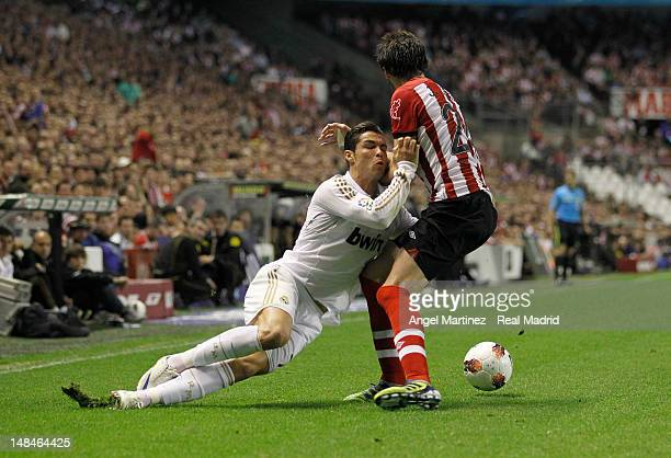 Cristiano Ronaldo of Real Madrid duels for the ball with Javi Martinez of Athletic during the La Liga match between Athletic Club and Real Madrid CF...