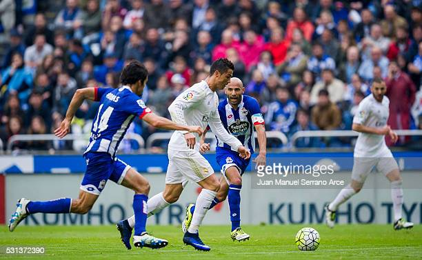 Cristiano Ronaldo of Real Madrid duels for the ball with Manuel Pablo of RC Deportivo La Coruna during the La Liga match between RC Deportivo La...