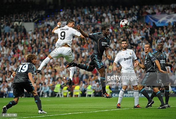 Cristiano Ronaldo of Real Madrid duels for the ball with Taye Taiwo of Marseille during the Champions League group C match between Real Madrid and...