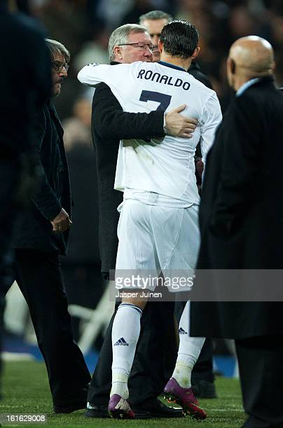 Cristiano Ronaldo of Real Madrid embraces Sir Alex Ferguson manager of Manchester United at the end of the UEFA Champions League Round of 16 first...