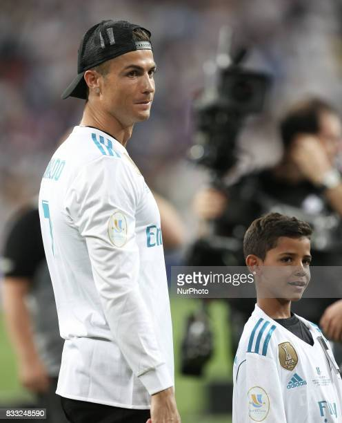 Cristiano Ronaldo of Real Madrid enters the pitch with his son Cristiano JR during the celebrations for winning the Spanish Super Cup in the return...