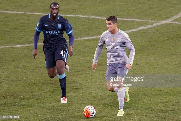Cristiano Ronaldo of Real Madrid evades Yaya Toure of Manchester City during the International Cup match beteween Real Madrid and Manchester City at...