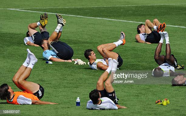 Cristiano Ronaldo of Real Madrid excercises besides his teammates at the end of a training session at the Valdebebas training ground on August 19,...