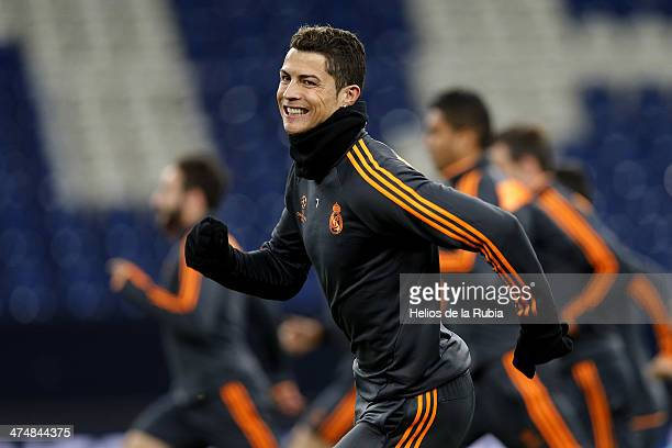 Cristiano Ronaldo of Real Madrid exercises during a training session ahead of their UEFA Champions League Round of 16 first leg match against FC...