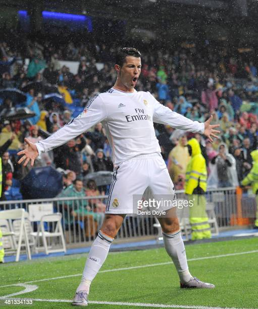 Cristiano Ronaldo of Real Madrid FC celebrates after scoring his team's opening goal during the La Liga match between Real Madrid CF and Rayo...
