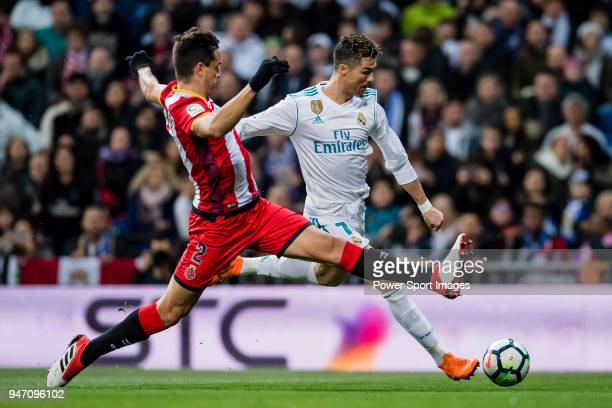 Cristiano Ronaldo of Real Madrid fights for the ball with Bernardo Jose Espinosa Zuniga of Girona FC in action during the La Liga 201718 match...