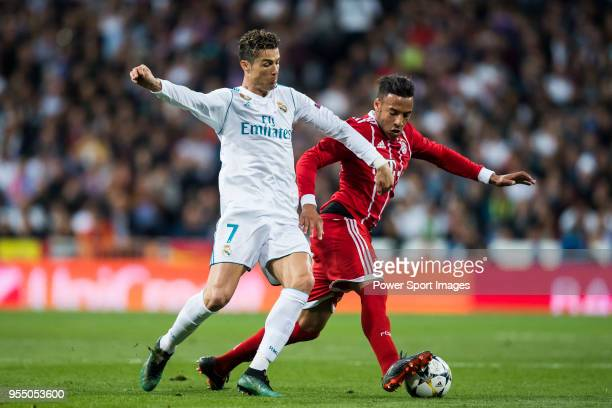 Cristiano Ronaldo of Real Madrid fights for the ball with Corentin Tolisso of FC Bayern Munich during the UEFA Champions League Semi Final Second Leg...