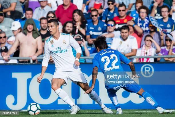 Cristiano Ronaldo of Real Madrid fights for the ball with Damian Nicolas Suarez Suarez of Getafe CF during the La Liga 201718 match between Getafe CF...