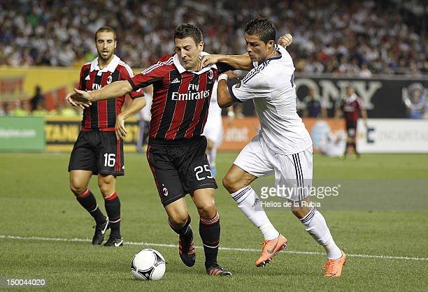 Cristiano Ronaldo of Real Madrid fights for the ball with Daniele Bonera of AC Milan during a World Football Challenge match between AC Milan and...