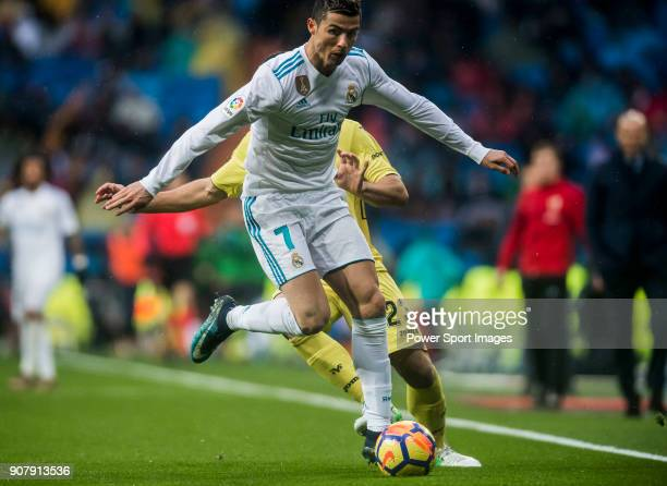 Cristiano Ronaldo of Real Madrid fights for the ball with Daniele Bonera of Villarreal CF during the La Liga 201718 match between Real Madrid and...