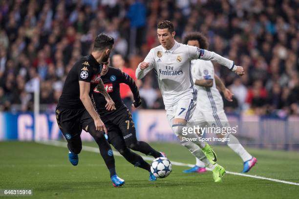 Cristiano Ronaldo of Real Madrid fights for the ball with Elseid Hysaj of SSC Napoli and teammate Jose Callejon with during the match Real Madrid vs...