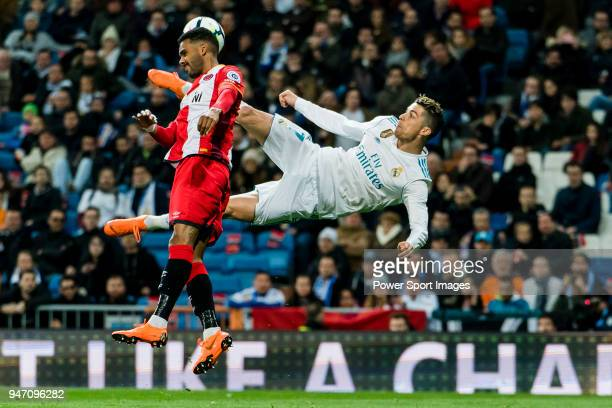 Cristiano Ronaldo of Real Madrid fights for the ball with Jonas Ramalho Chimeno of Girona FC during the La Liga 201718 match between Real Madrid and...