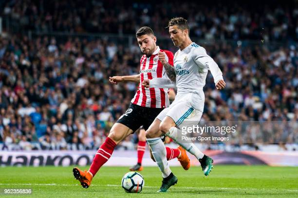 Cristiano Ronaldo of Real Madrid fights for the ball with Unai Nunez Gestoso of Athletic Club de Bilbao during the La Liga match between Real Madrid...